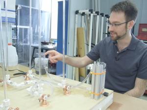 Dr. Alex Rattner demonstrating an experiment
